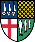 A black outlined shield with a green background and three white fish in the bottom right, a white background with a red cross in the bottom left, a blue background with three white ships in the top left, and a yellow background with a black criss-cross pattern on the top right